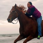 Riding like the wind on a Thoroughbred on the beach!